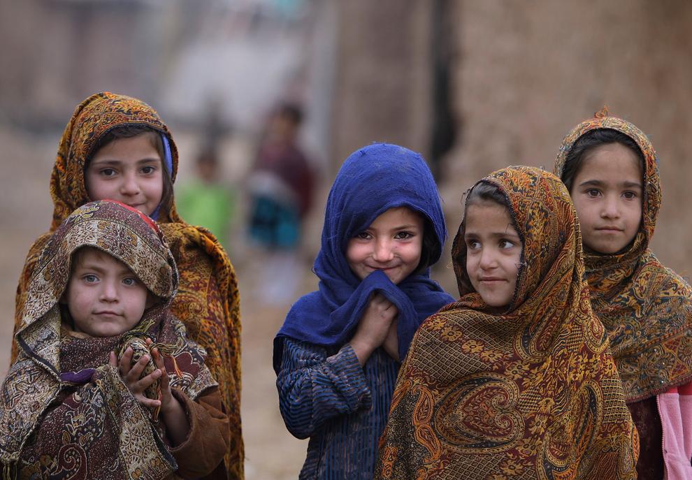 Afghan refugee girl smiles